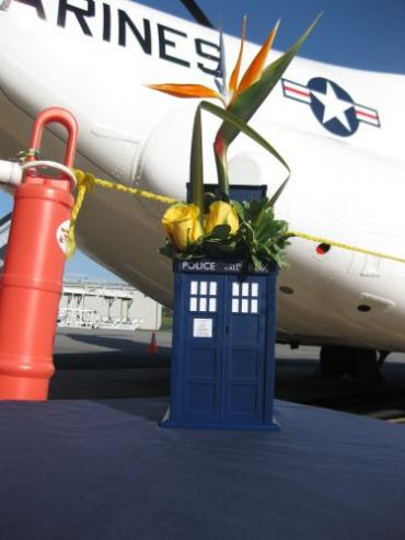 Tropical Wedding Centerpiece presented in Tardis cookie jar
