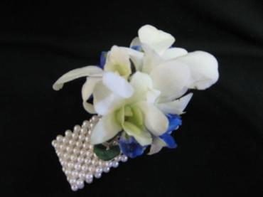 White dendrobium orchid wrist corsage fo Mother of the Bride