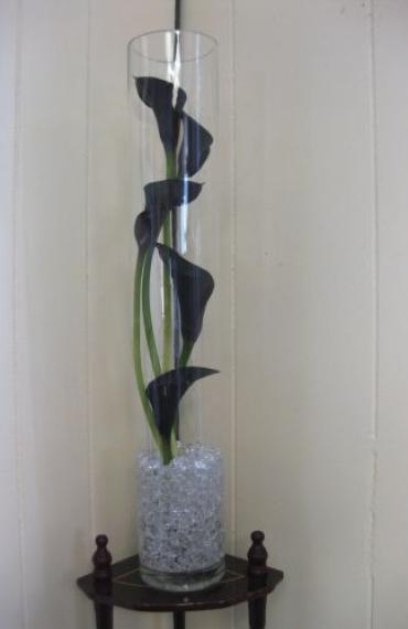 Black mini calla lilies staggered in glass cylinder wedding cent