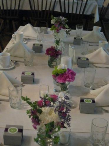 Mixed lavender, green and white wedding centerpieces at Stone Ba